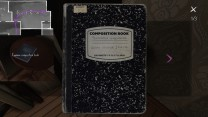"""25. On a small circular table next to the bed in the guest room, we find a composition book that Sam has turned into a """"ghost sighting journal."""""""