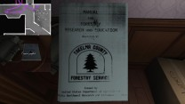 21. If we pick it up, we find a photocopied forestry manual beneath. Pretty boring stuff, so far.